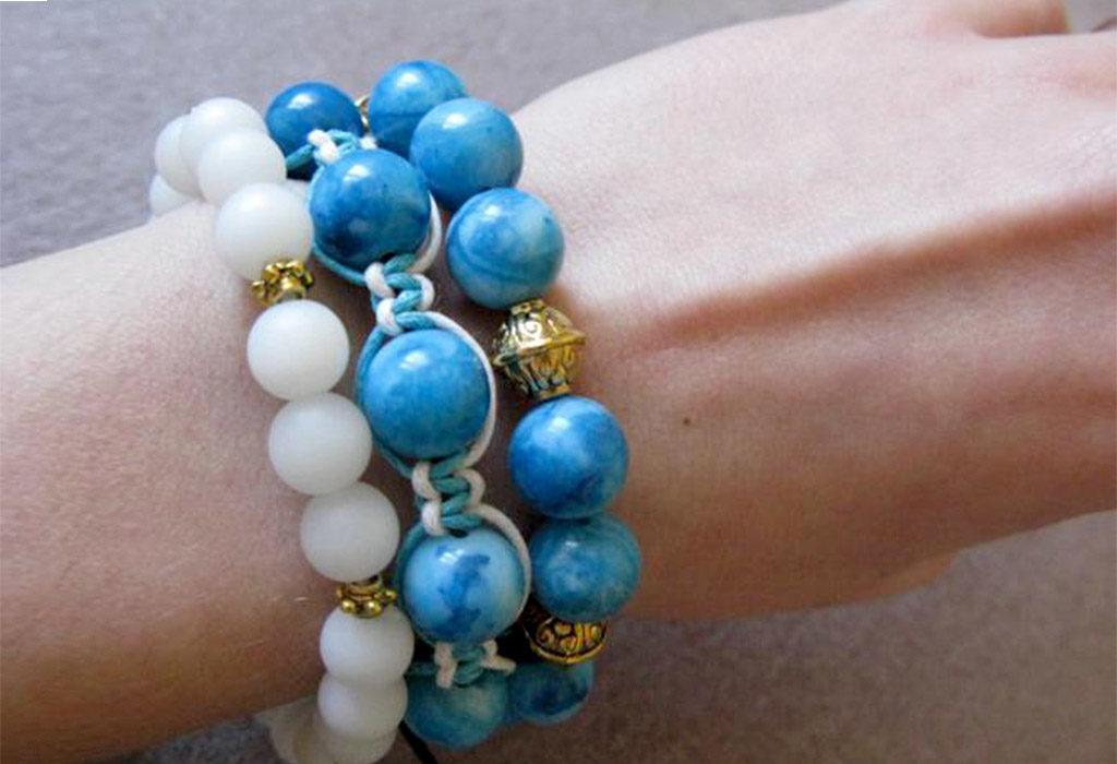 Braslet_shambala_na_ruke-1024x700 Браслет шамбала: значение и соответствие цвета бусин буддийского амулета, на какой руке носить украшение