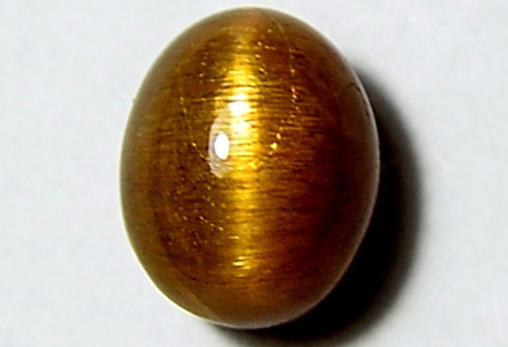 Камень коричневый кошачий глаз